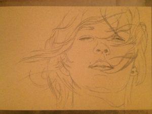 Sketch of a face on sennlier pastel card